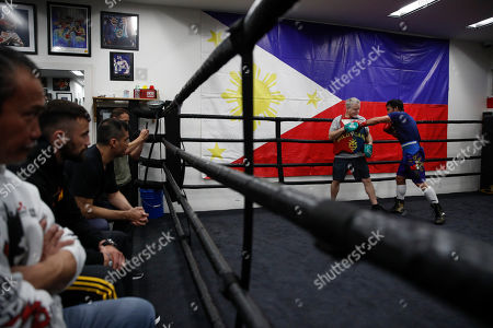 Manny Pacquiao, Freddie Roach. Boxer Manny Pacquiao, far right, trains with Freddie Roach at the Wild Card Boxing Club, in Los Angeles. The Filipino legend is in the winter of his career, gearing up for what could be one big last fight. Saturday's bout versus Broner isn't it, but Pacquiao trains with the knowledge that a second megafight against Floyd Mayweather could possibly be just months away if all goes well