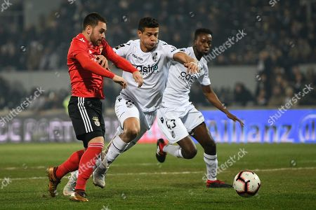Vitoria de Guimaraes player, Yordan Osorio (C), fights for the ball with Andrija Zivkovic (L) of Benfica during their Portugal Cup soccer match held at Dom Afonso Henriques Stadium, Guimaraes, northern Portugal, 15 January 2019.