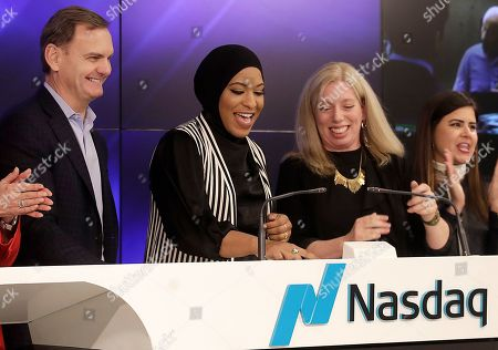 Ibtihaj Muhammad, Bruce Aust, Nicola Corzine. Olympic fencer Ibtihaj Muhammad, center left, hits a button to remotely ring the Nasdaq Stock Market closing bell between Bruce Aust, vice chairman at Nasdaq, left, and Nicola Corzine, executive director of the Nasdaq Entrepreneurial Center, center right, in San Francisco, . Muhammad, the first Muslim-American woman to compete for the U.S. wearing a hijab, won a bronze medal at the 2016 Summer Olympics in Rio de Janeiro, Brazil