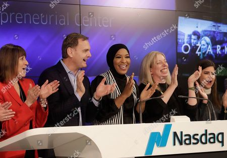 Ibtihaj Muhammad, Bruce Aust, Nicola Corzine. Olympic fencer Ibtihaj Muhammad, center, applauds before remotely ringing the Nasdaq Stock Market closing bell between Bruce Aust, vice chairman at Nasdaq, second from left, and Nicola Corzine, executive director of the Nasdaq Entrepreneurial Center, second from right, in San Francisco, . Muhammad, the first Muslim-American woman to compete for the U.S. wearing a hijab, won a bronze medal at the 2016 Summer Olympics in Rio de Janeiro, Brazil