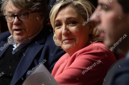 Gilbert Collard and Marine Le Pen during the weekly session of questions to the government at the National Assembly.