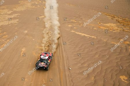 Driver Stephane Peterhansel, of France, and co-driver David Castera, of France, race their Mini during the stage eight of the Dakar Rally between San Juan de Marcona and Pisco, Peru