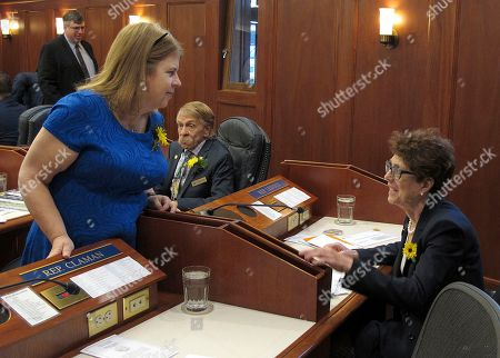 Tammie Wilson, Gabrielle LeDoux. Alaska state Rep. Tammie Wilson, left, speaks with Rep. Gabrielle LeDoux on the floor of the House, in Juneau, Alaska. Tuesday was the first day of the legislative session