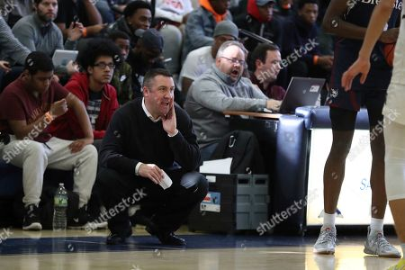 Brewster Academy's head coach Jason Smith is seen on the sidelines against Westtown School during a high school basketball game on in the Bronx, NY