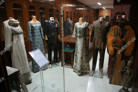 Stock Photo of Clothes that belonged to the late Shah Mohammad Reza Pahlavi and then Empress Farah Pahlavi are displayed at Niavaran Palace, now a museum, that was the primary and last residence of late Shah Mohammad Reza Pahlavi and his family prior to leaving Iran for exile during the 1979 Islamic Revolution, in northern Tehran, Iran. The palace complex of mansions on a 27-acre plot, nestled against the Alborz Mountains, now welcomes the public to marvel at the luxuries the shah enjoyed as Iran's monarch for nearly four decades. It costs about $1 to enter