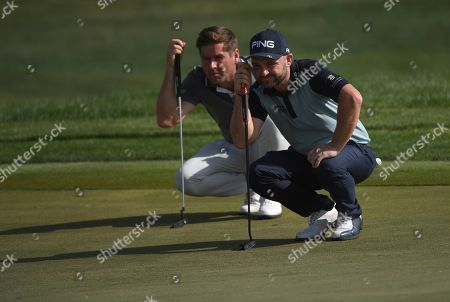 Robert Rock, Andy Sullivan. Robert Rock, left, and Andy Sullivan of England check the 9th green in round one of the Abu Dhabi Championship golf tournament in Abu Dhabi, United Arab Emirates