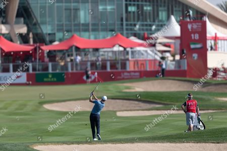 Ross Fisher of England plays an approach shot to the green on the 18th hole, during the first round of the Abu Dhabi HSBC Golf Championship in Abu Dhabi, United Arab Emirates, 16 January 2019.
