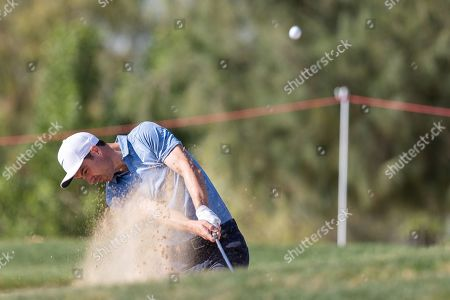 Ross Fisher of England chips out of a bunker on the 18th hole, during the first round of the Abu Dhabi HSBC Golf Championship in Abu Dhabi, United Arab Emirates, 16 January 2019.