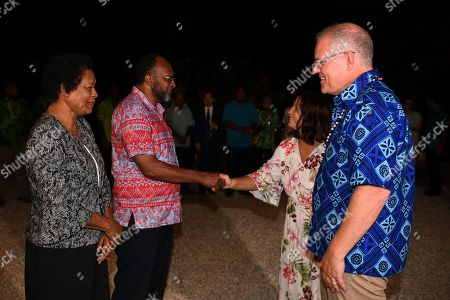 Prime Minister of Vanuatu Charlot Salwai (2-L) and his wife Marie-Justine Salwai (L) greet Australian Prime Minister Scott Morrison (R) and his wife Jenny (2-R) to a dinner in Port Vila, Vanuatu, 16 January 2019. Prime Minister Morrison will discuss Australian infrastructure investment, the Pacific labor hire scheme, and building cultural, economic and social ties between the two countries.