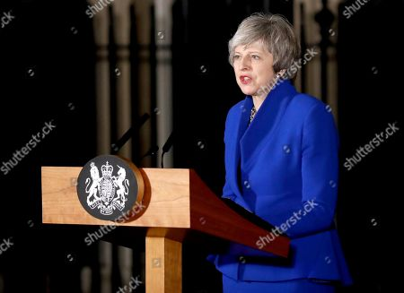 Theresa May addresses the media, London