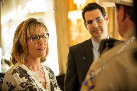 Felicity Huffman as Agent Clara Dillard and Andrew Leeds as Agent Ken Stevenson
