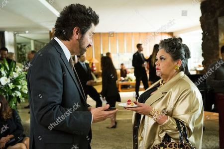 Ray Romano as Rick Moreweather and Lidia Porto as Amara De Escalones