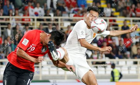 Zhang Linpeng (R) of China in action against Kim Young-gwon of South Korea during the 2019 AFC Asian Cup group C preliminary round match between South Korea and China in Abu Dhabi, United Arab Emirates, 16 January 2019.