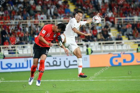 China's defender Wu Xi and South Korea's defender Kim Young-Gwon jump for the ball during the AFC Asian Cup group C soccer match between South Korea and China at Al Nahyan Stadium in Abu Dhabi, United Arab Emirates