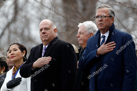 Larry Hogan, Yumi Hogan, Jeb Bush. Maryland Gov. Larry Hogan, center, stands between first lady Yumi Hogan, left, and former Florida Gov. Jeb Bush during a rendition of the national anthem at Hogan's inauguration ceremony, in Annapolis, Md. Hogan is the first Republican governor to be re-elected in the state since the 1950s