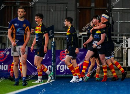 Wilson's Hospital School vs Temple Carrig School. Temple Carrig's Josh Sproul celebrates scoring a try with teammates
