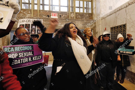 "Stock Image of Sonja Spoo, center, associate campaign director of Ultra Violet, leads chants during an R. Kelly protest in the lobby of Sony headquarters, in New York, . Kelly has been under fire since the recent airing of a Lifetime documentary ""Surviving R. Kelly ."" He has denied all allegations of sexual misconduct involving women and underage girls"
