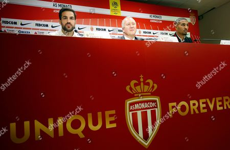 AS Monaco's new players Cesc Fabregas (L) and William Vainqueur (R) with AS Monaco's vice president Vadim Vasilyev (C) attend a press conference during their official presentation of the new players at Louis II stadium in Monaco, 16 January 2019.