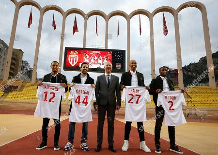 AS Monaco's new players William Vainqueur (L), Cesc Fabregas (2-L), Naldo (2-R), Fode Ballo-Toure (R) and AS Monaco's vice president Vadim Vasilyev (C) pose after a press conference during the official presentation of the new players at Louis II stadium in Monaco, 16 January 2019.