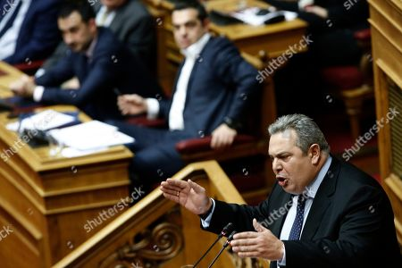 Stock Image of Former Greek Defense Minister and former partner of the government coalition, Panos Kammenos (R) delivers his speech as Greek Prime Minister Alexis Tsipras (2-R) is seen in the background, during a debate on the vote of confidence in the government, in the parliament's plenum, in Athens, Greece, 16 January 2019. Greek deputies will be called to give their vote of confidence in the government on Wednesday midnight after a two-day debate in parliament.