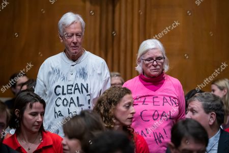 A pair of protesters attend the confirmation hearing for Acting Environmental Protection Agency administrator Andrew Wheeler at the Senate Environment and Public Works Committee on Capitol Hill in Washington, DC, USA, 16 January 2019. If confirmed, Wheeler would permanently replace former EPA administrator Scott Pruitt.
