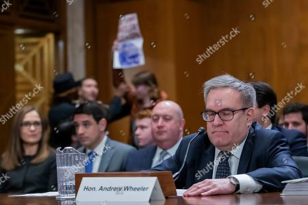 Acting Environmental Protection Agency administrator Andrew Wheeler pauses for a protester during his full confirmation hearing with the Senate Environment and Public Works Committee on Capitol Hill in Washington, DC, USA, 16 January 2019. If confirmed, Wheeler would permanently replace former EPA administrator Scott Pruitt.