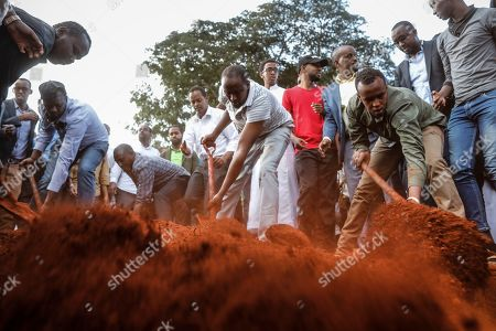 Men burry the bodies of felllow Muslim men Abdalla Mohammed Dahir, 28, and his age mate Feisal Ahmed Rashid, who were killed in the DusitD2 Hotel and Office Complex attack, at a cemetery in Nairobi, Kenya, 16 January 2019, a day after the attackers stormed the compound killing several people in an attack claimed by Somalia's Islamist militant group al-Shabab. Kenyan President Uhuru Kenyatta said 14 people were killed in an attack and security forces have 'neutralised' all attackers.