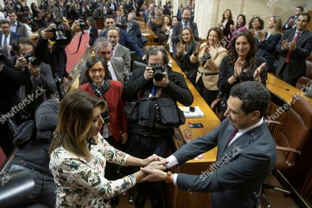 New Andalusian regional President Juanma Moreno (R) is congratulated by outgoing President Susana Diaz (L) during a plenary session at the Andalusian Parliament in Seville, Spain, 16 January 2019. Moreno was elected after obtaining absolute majority of the Chamber in the first voting.