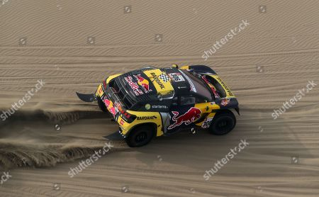 French Sebastien Loeb competes in his Peugeot during the ninth stage of the Rally Dakar 2018, in Pisco, Peru, 16 January 2019.