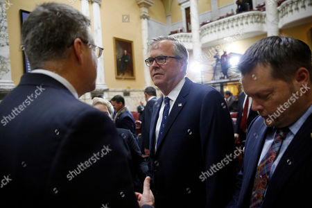 William Porter. Former Florida Gov. Jeb Bush chats in the Maryland State Senate chamber after watching Maryland Gov. Larry Hogan take the oath of office, in Annapolis, Md
