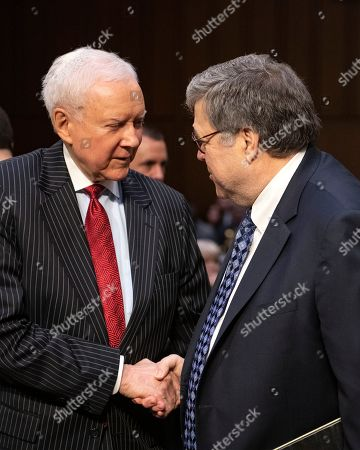 Stock Image of William P. Barr, right, shaking hands with former United States Senator Orrin Hatch (Republican of Utah), left, prior to giving testimony before the US Senate Committee on the Judiciary on his nomination to be Attorney General of the US on Capitol Hill in Washington, DC.