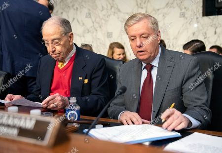 United States Senator Lindsey Graham (Republican of South Carolina), Chairman, US Senate Judiciary Committee, left and United States Senator Chuck Grassley (Republican of Iowa), right, look over their notes prior to hearing William P. Barr testify before the committee on his nomination to be Attorney General of the US on Capitol Hill in Washington, DC.