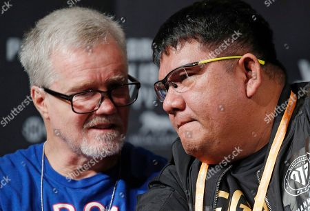 Stock Photo of Buboy Fernandez, right, and Freddie Roach speak at a news conference for an upcoming fight between Manny Pacquiao and Adrien Broner, in Las Vegas
