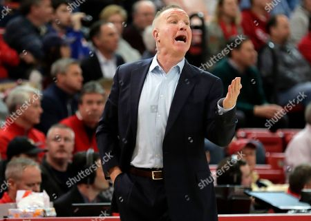 St. John's head coach Chris Mullin calls out to his team during the first half of an NCAA college basketball game against Creighton, in New York