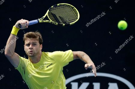United States' Ryan Harrison hits a forehand return to Russia's Daiil Medvedev during their second round match at the Australian Open tennis championships in Melbourne, Australia