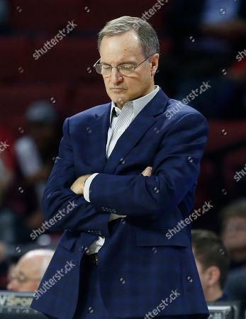 Oklahoma coach Lon Kruger looks down late in the second half of the team's 74-61 loss to Kansas State in an NCAA college basketball game in Norman, Okla