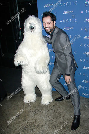 Joe Penna with toy polar bear