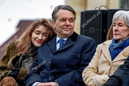 Serena Colyer rests her head on her father's shoulder former Kansas Governor Doctor Jeff Colyer while they attend the inauguration of Governor Laura Kelly who defeated Colyer in the election last year. Former Governor Kathleen Sebelius is seated next to Governor Colyer