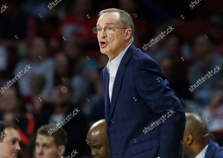 Oklahoma head coach Lon Kruger on the sidelines during an NCAA college basketball game between Kansas State and Oklahoma in Norman, Okla