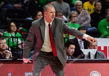 North Dakota Fighting Hawks head coach Brian Jones directs his team during a NCAA men's college basketball game between South Dakota State Jackrabbits and the University of North Dakota Fighting Hawks at Betty Engelstad Sioux Center, in Grand Forks, ND. SDSU won 78-74