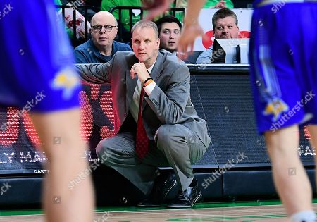 North Dakota Fighting Hawks head coach Brian Jones watches his team during a NCAA men's college basketball game between South Dakota State Jackrabbits and the University of North Dakota Fighting Hawks at Betty Engelstad Sioux Center, in Grand Forks, ND. SDSU won 78-74