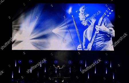 """Singer Brandi Carlisle performs underneath an image of the late singer Chris Cornell during """"I Am The Highway: A Tribute to Chris Cornell"""" at The Forum, in Inglewood, Calif"""