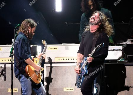 "Dave Grohl, Chris Shiflett. Dave Grohl, right, and Chris Shiflett of Foo Fighters perform during ""I Am The Highway: A Tribute to Chris Cornell"" at The Forum, in Inglewood, Calif"