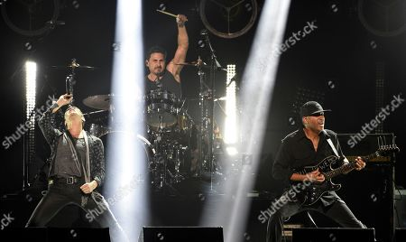 "Stock Picture of Perry Farrell, Brad Wilk, Tom Morello. Singer Perry Farrell, left, performs with Brad Wilk, center, and Tom Morello of Audioslave during ""I Am The Highway: A Tribute to Chris Cornell"" at The Forum, in Inglewood, Calif"