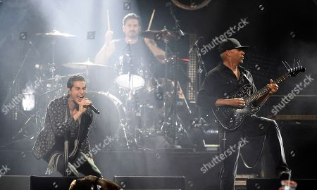 "Stock Photo of Perry Farrell, Brad Wilk, Tom Morello. Singer Perry Farrell, left, performs with Brad Wilk, center, and Tom Morello of Audioslave during ""I Am The Highway: A Tribute to Chris Cornell"" at The Forum, in Inglewood, Calif"
