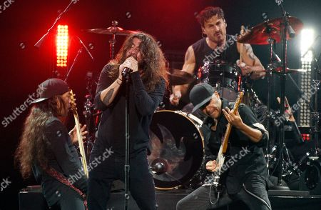 "Dave Grohl, Robert Trujillo, Brad Wilk, Tom Morello. Dave Grohl, center, performs with Metallica bassist Robert Trujillo, left, and Audioslave members Brad Wilk, top, and Tom Morello during ""I Am The Highway: A Tribute to Chris Cornell"" at The Forum, in Inglewood, Calif"