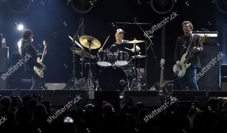 """Kim Thayil, Matt Cameron, Ben Shepherd. From left, Soundgarden band members Kim Thayil, Matt Cameron and Ben Shepherd perform during """"I Am The Highway: A Tribute to Chris Cornell"""" at The Forum, in Inglewood, Calif"""