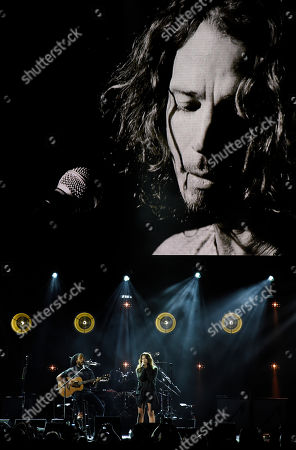 """Toni Cornell, Ziggy Marley. Toni Cornell, daughter of the late singer Chris Cornell, performs with Ziggy Marley, bottom left, underneath a video image of her father during """"I Am The Highway: A Tribute to Chris Cornell"""" at The Forum, in Inglewood, Calif"""
