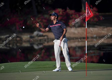 Pablo Larrazabal of Spain throws the ball to his caddie on the 12th green in round two of the Abu Dhabi Championship golf tournament in Abu Dhabi, United Arab Emirates