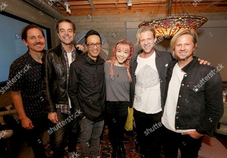 Chad Butler, Drew Shirley, Jerome Fontamillas, Jon Foreman, Tim Foreman, Lindsey Stirling. Lindsey Stirling poses with Chad Butler, from left, Drew Shirley, Jerome Fontamillas, Jon Foreman and Tim Foreman at the Switchfoot album release at the Microsoft Lounge on in Culver City, Calif
